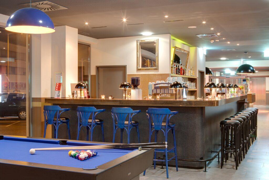 Bar area at MEININGER Hotel Salzburg City Center