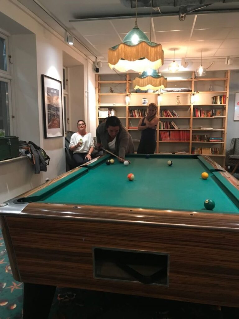 playing pool at Urban House Copenhagen by MEININGER
